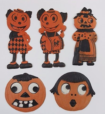 Jack O'Lantern and Mickey Mouse style characters made of embossed cardboard.