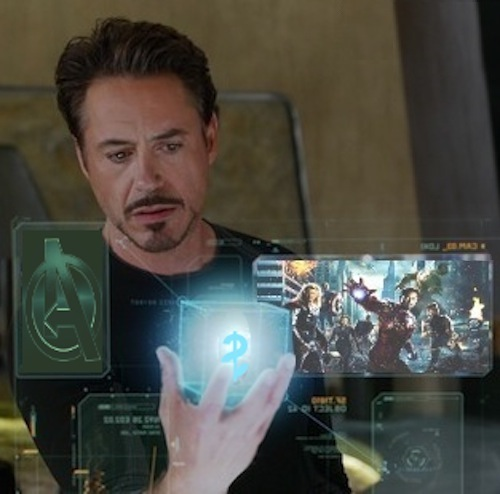 photo-illustration of Tony Stark holding Cosmic Cube with dollar sign amidst viewscreens depicting Avengers promotional images