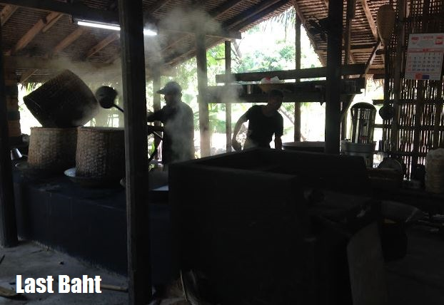 workers produce palm sugar in Thailand
