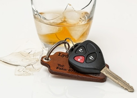A glass of wine and car keys.