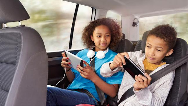 Teens on technology in a car