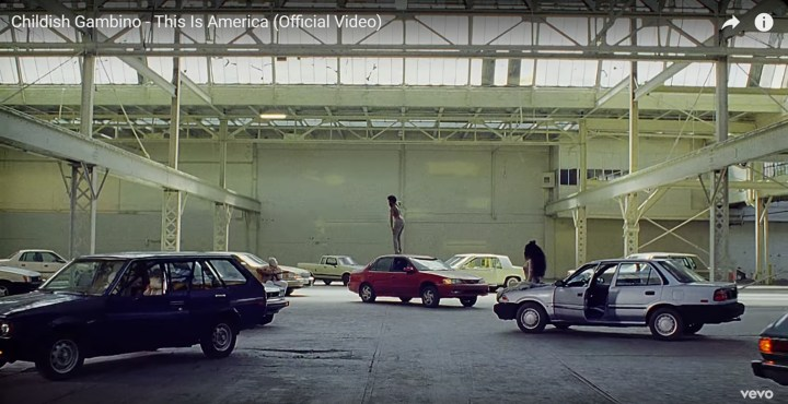 Childish Gambino's This is America - Easter egg - Most of the car doors are open. This is a taunt at the rampant racism in the American police force, where black drivers are forced to pull over while driving by the police at a far higher rate than white folk.