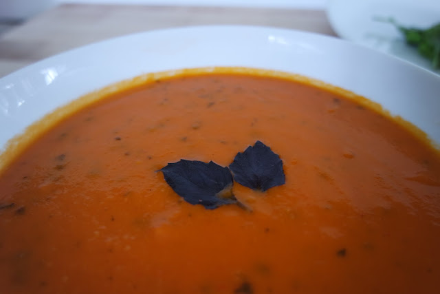 Smoked Creole Tomato Soup garnished with Purple Basil