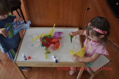 flower craft for kids made by cutting and gluing painted tissue paper