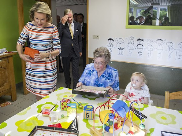 Queen Mathilde visit uberge du Vivier' care center and business center in Libin. Mathilde wore Natan dress