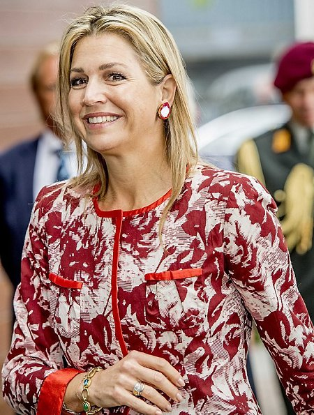 Queen Maxima wore Natan outfits, dress and coat, Natan shoes and carried A Bag With A Story Maharlika Snake Clutch