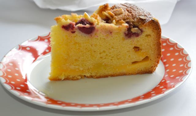 A slice of raspberry, almond and custard cake