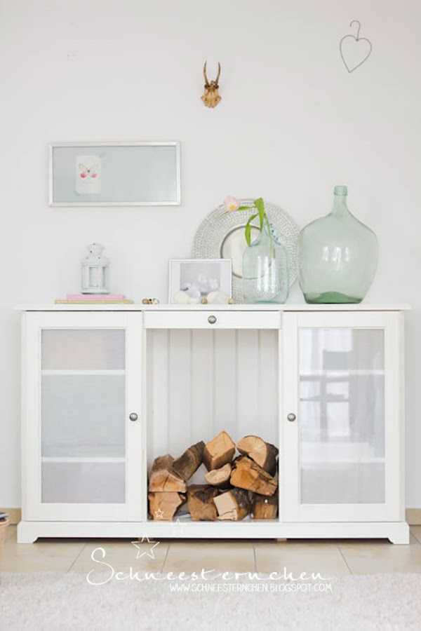 bottle vases/demijohns and a stunning moroccan tray. I really love how the top of this little side table unit has been arranged and displayed! Glorious Shabby Chic Living Room Inspiration You Will Love!