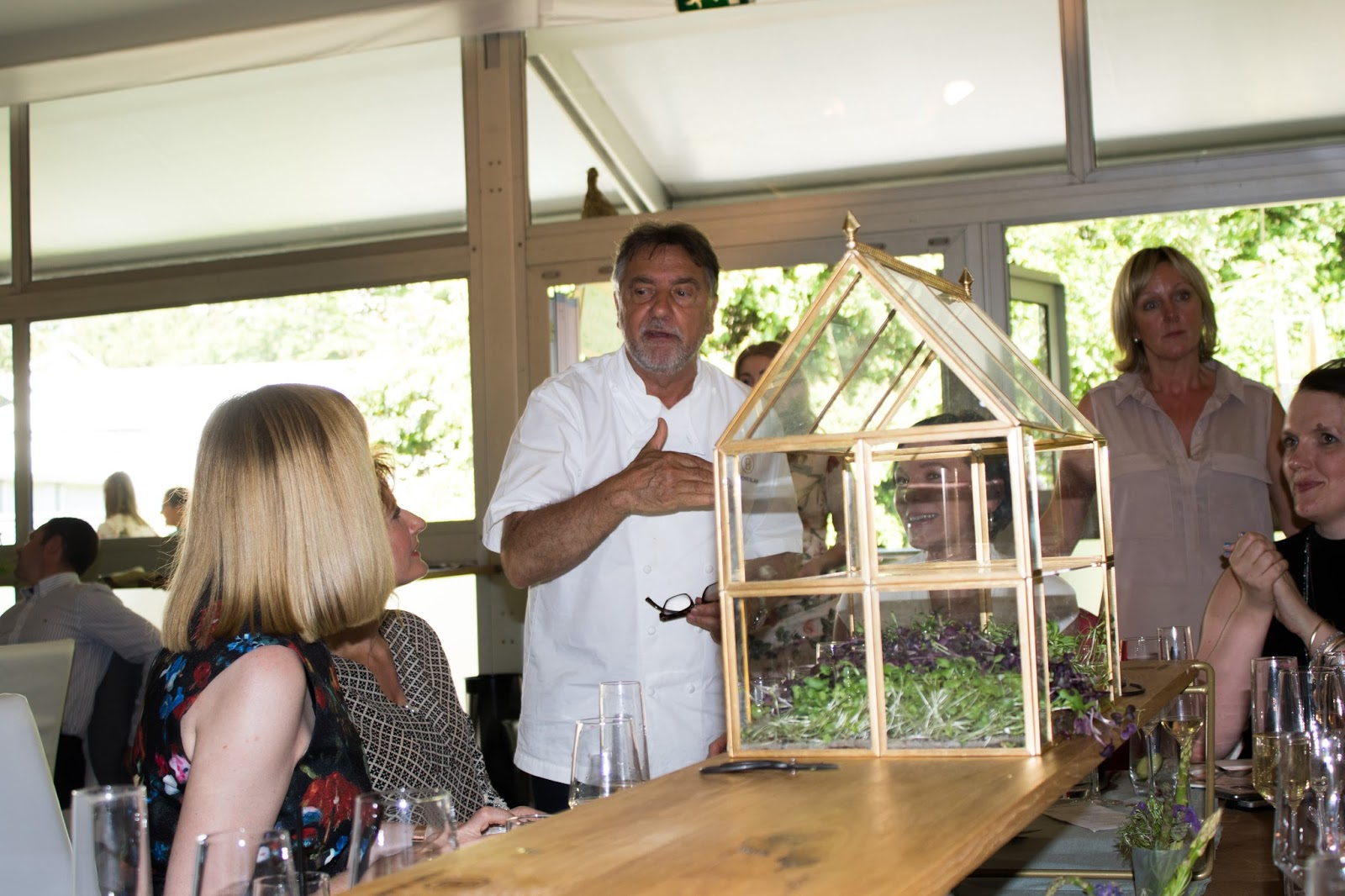 Raymond Blanc talking to guests at Chelsea Flower Show 2017