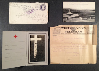 A collection of papers including a telegram and an envelope.