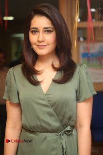 Actress Raashi Khanna Stills in Green Short Dress at Mirchi 95 Suno Aur Mercedes Jeeto Contest 0034