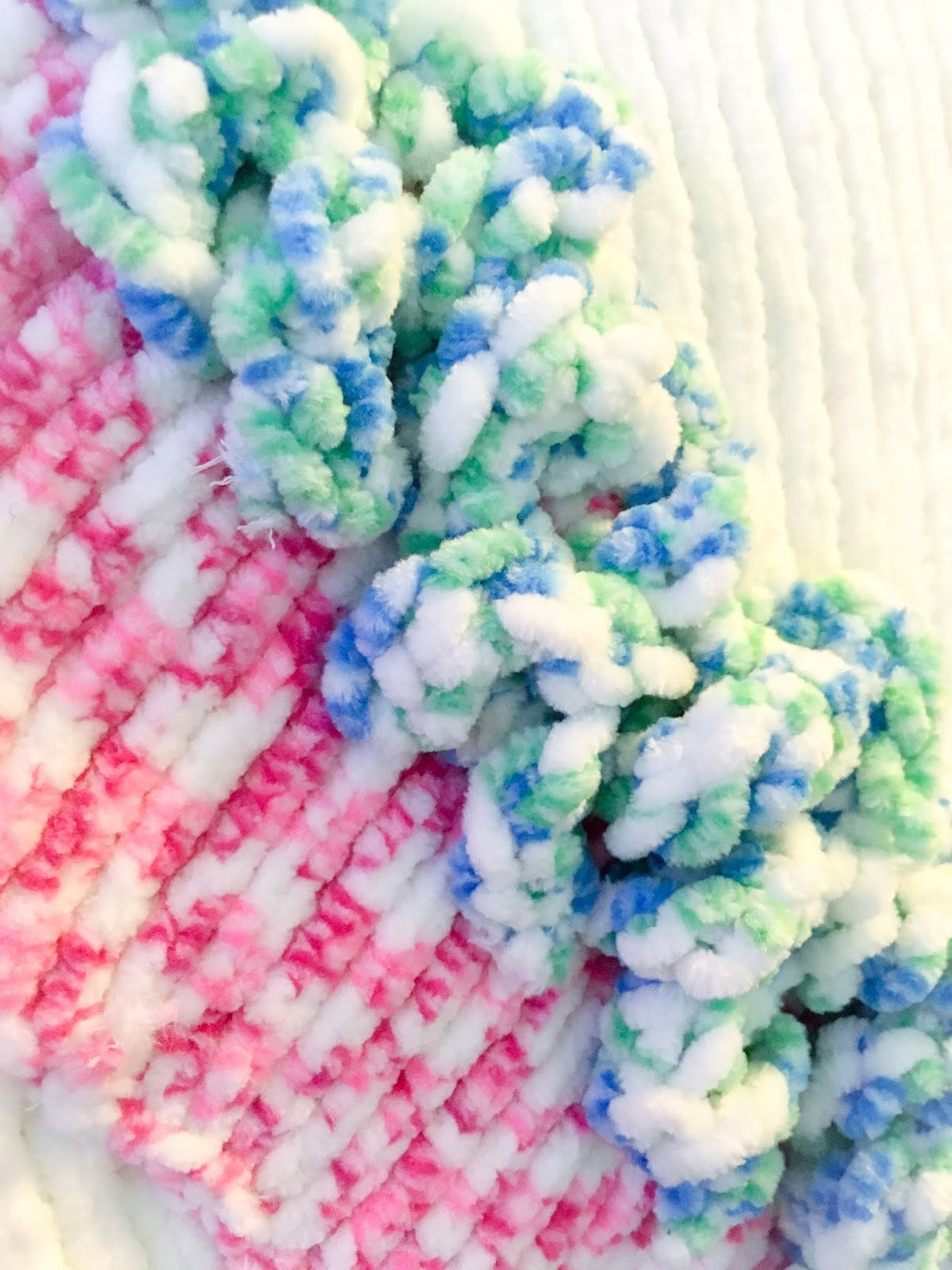 Close up of knitted unicorn cushion cover on Blooming Fiction book blog