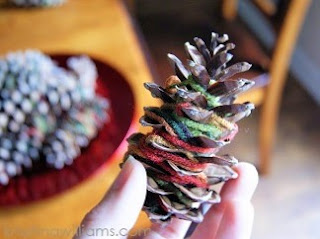 http://www.krisztinawilliams.com/2013/10/crafting-with-kids-easy-fall-pine-cone.html