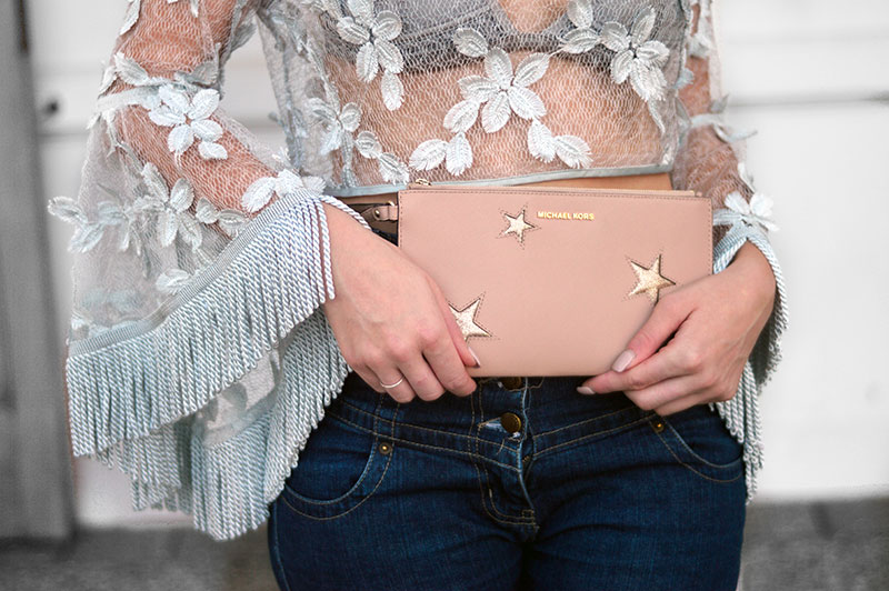 street style outfit details michael kors silver star clutch sheer top with 3d florals fringe bell sleeves
