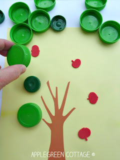 apple hunting activity for kids using plastic bottle caps