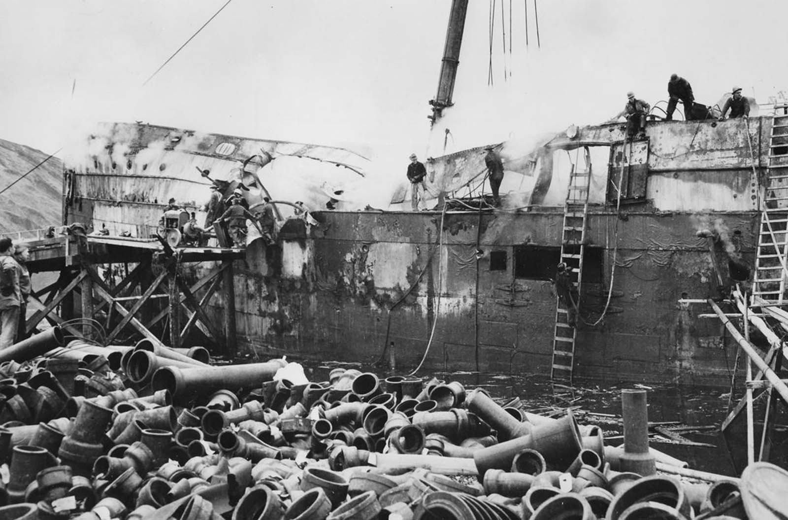 The ruins of a bombed ship at Dutch Harbor, Alaska, on June 5, 1942.