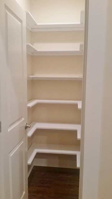 kitchen pantry with wood shelving