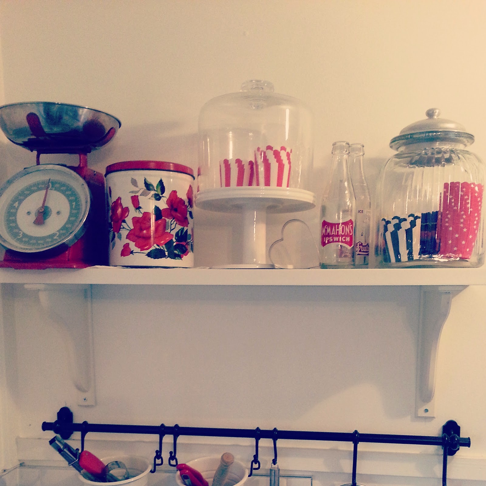 kitchen vintage retro kitchenalia scales cupcake pans cake stand on shelf white and red