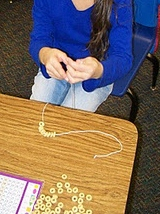 Stringing 100 items is always fun on the 100th day of school! Click through for more details! Great for your preschool, Kindergarten, 1st, or 2nd grade classroom or homesschool students.