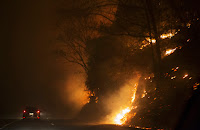 Fire erupts on the side of The Spur on Highway 441 between Gatlinburg and Pigeon Forge, TN, on Monday night, November 28, 2016. In Gatlinburg, smoke and fire caused the mandatory evacuation of downtown and surrounding areas. (Image credit: Jessica Tezak/Knoxville News Sentinel via AP) Click to Enlarge.
