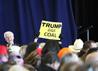 Trump digs coal sign at Louisiana GOP rally in Dec 2016 (Credit: Tammy-Anthony-Baker_creative-commons) Click to Enlarge.