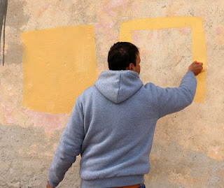 Ivan painting the test squares on the wall