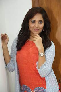 Actress Anasuya Bharadwaj in Orange Short Dress Glam Pics at Winner Movie Press Meet February 2017 (64).JPG
