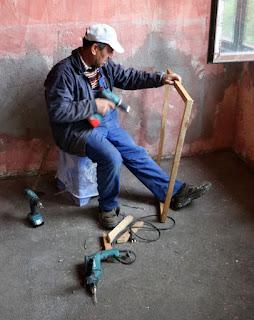 Bekir constructing a frame