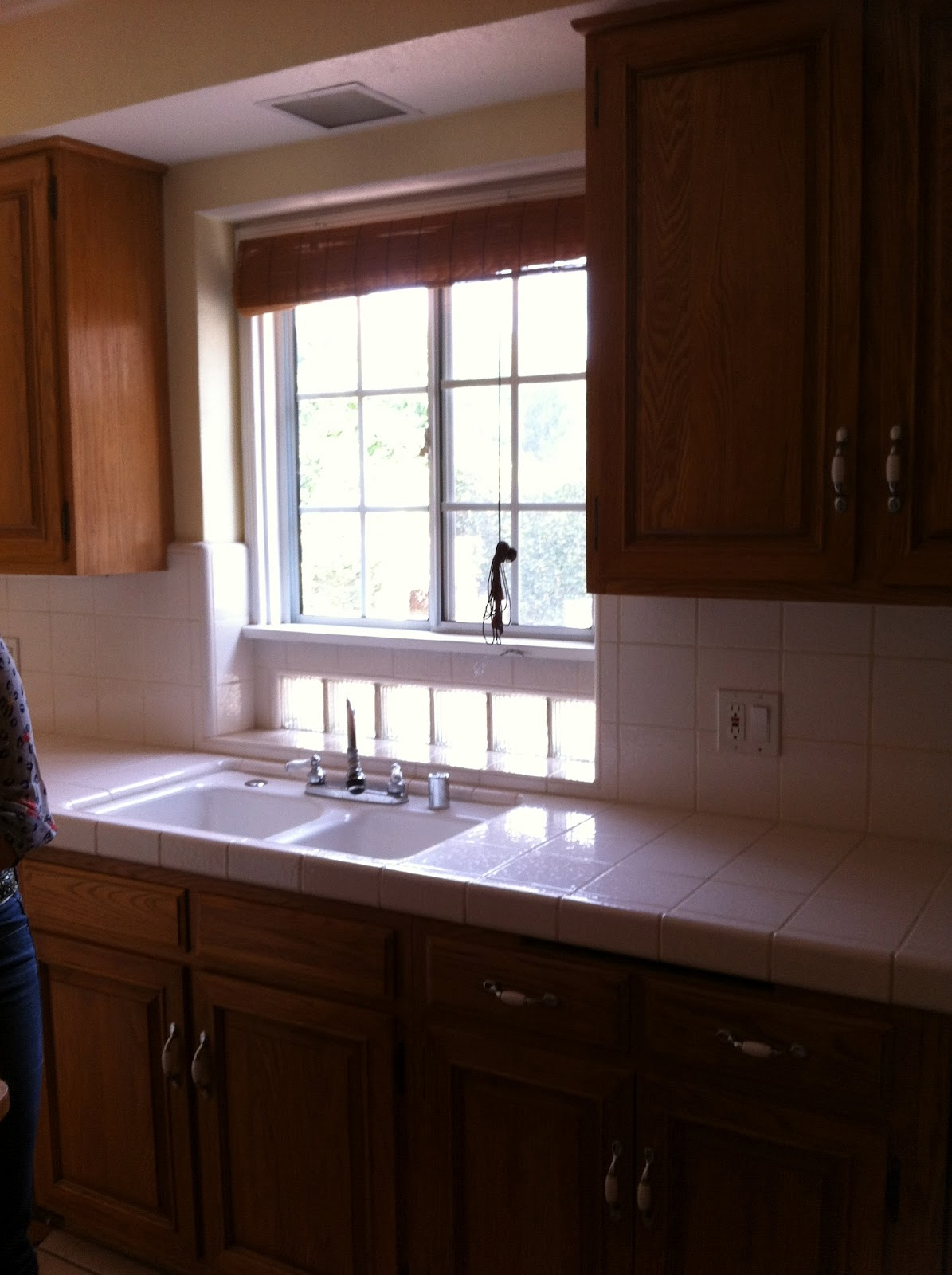 White Pull Out Kitchen Faucet Emi Interior Design Inc House Hunters Renovation Kitchen