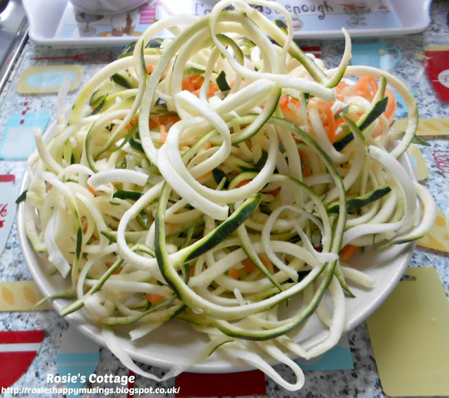 My first attempt at spiralizing and cream cheese zucchini noodles recipe:  I spiralized two zucchini (courgettes) and added a carrot to make it look pretty :)
