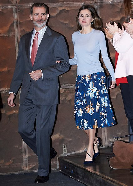 Queen Letizia wore Hugo Boss Fayme crew neck wool sweater and Hugo Boss Viplisa Skirt, Carolina Herrera sandals and she carries Hugo Boss clutch