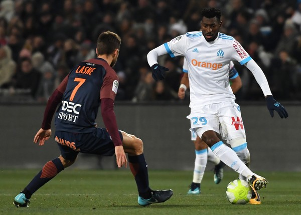 Montpellier's French midfielder Paul Lasne (L) vies with Marseille's French midfielder Andre-Frank Zambo Anguissa during the French L1 football match between MHSC Montpellier and Marseille on December 3, 2017 at La Mosson Stadium in Montpellier, southern France.