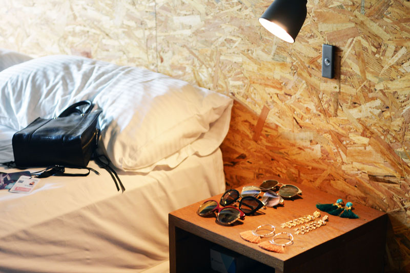 fashion week hotel room sunglasses displayed on table
