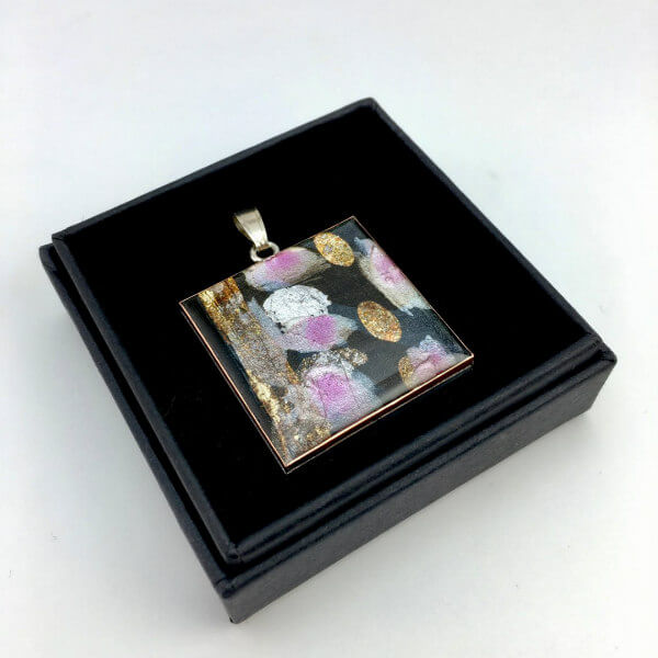 square modern painted pendant with resin coating in square black box