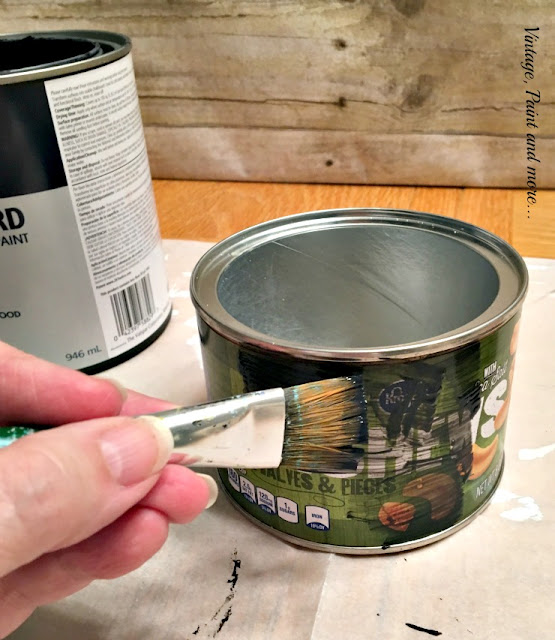 painting a cashew can with black chalkboard paint