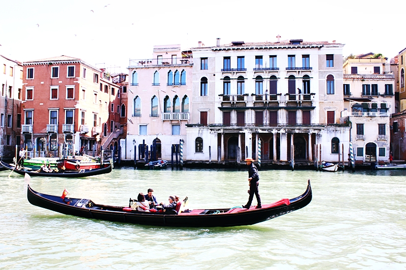Venice canals with gondolas