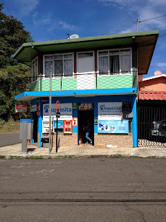 colorful street corner drug store in Puriscal