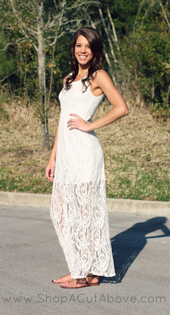 Model wearing casual white lace dress