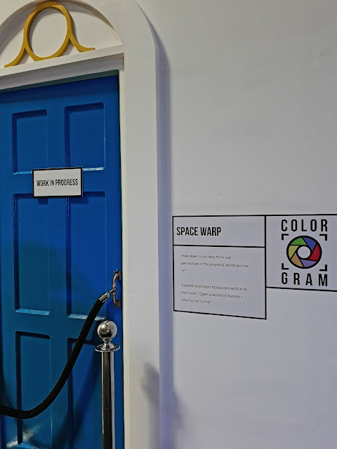 B. Space Warp  - How does color help form our perception of the physical world we llive in? Explore and learn space perception in this room. Open a world of illusion -  and try not to trip!