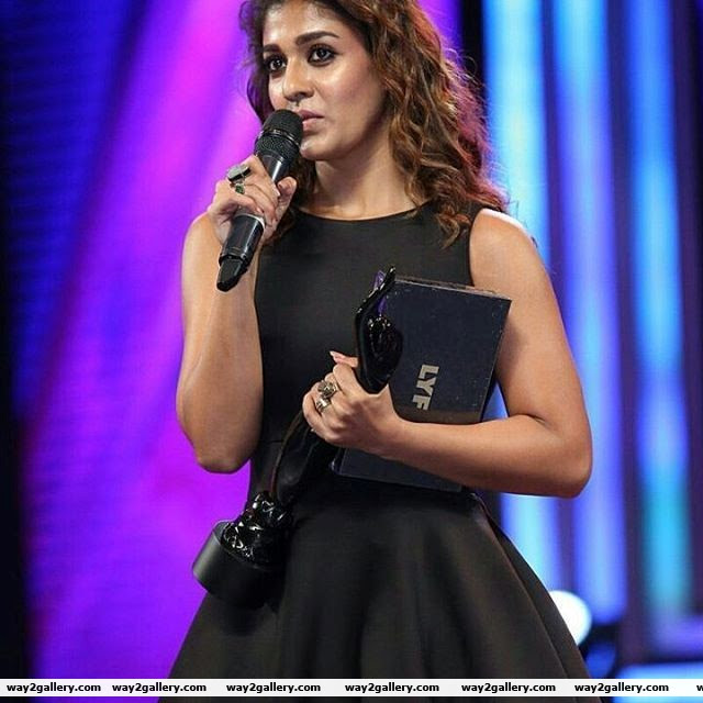 ladysuperstar with the black lady in hand nayanthara
