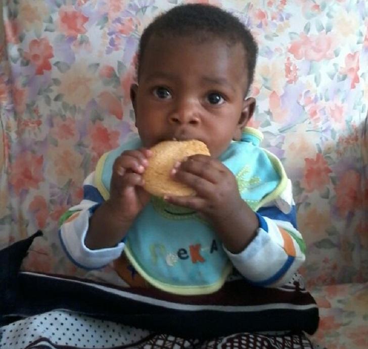 Kid eating a cookie