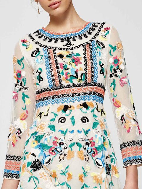 http://www.casualchic.es/es/productos/detalles/vestido-largo-de-tul-con-cuello-redondo-de-manga-larga-con-bordado-de-flores-/3486