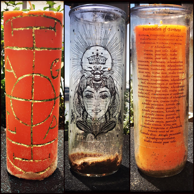 A candle which has an inscription to the Goddess Fortuna on the reusable glass sleeve.
