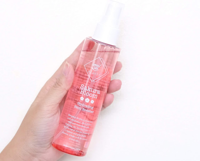 a photo of Happy Skin Beauty Sakura Bloom Hydrating Skin Booster review by Nikki Tiu www.askmewhats.com