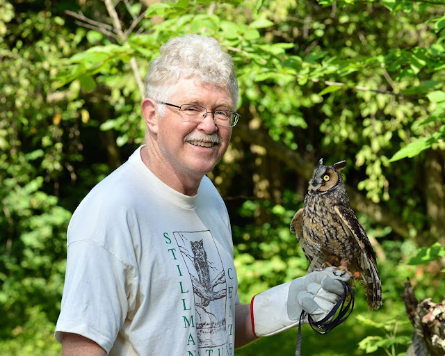 Mark Spreyer from Stillman Nature Center with owl from the center.