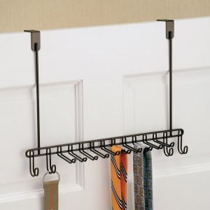 A Tie rack with two clean ties and a belt
