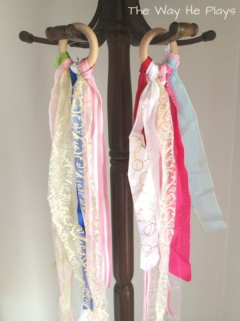 Two ribbon rings hanging from hooks
