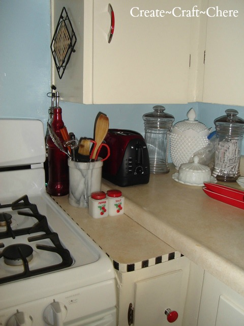 Retro kitchen makeover with antique salt and pepper shakers, depression glass with Mary Engelbreit inspirations