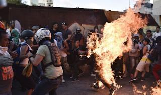 Venezuela mobs kick, burn thieves in lynching epidemic