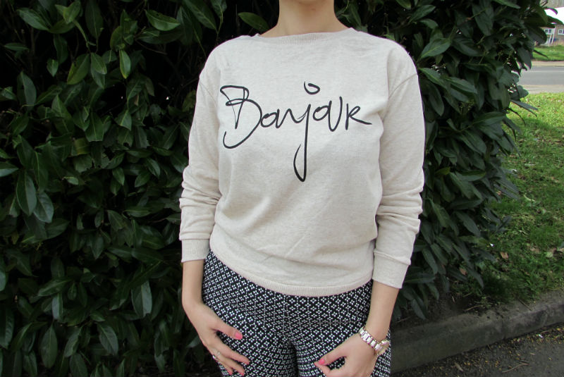a slogan sweater